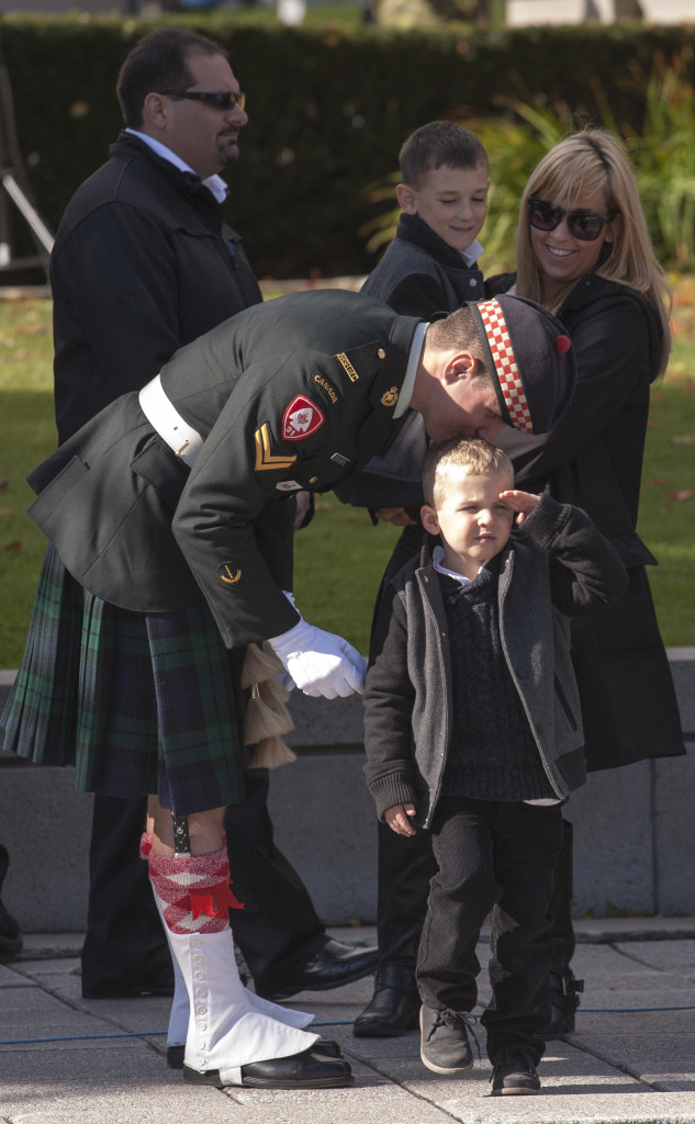 Corporal Nathan Cirillo's nephew Cameron Cirillo marches playfully.
