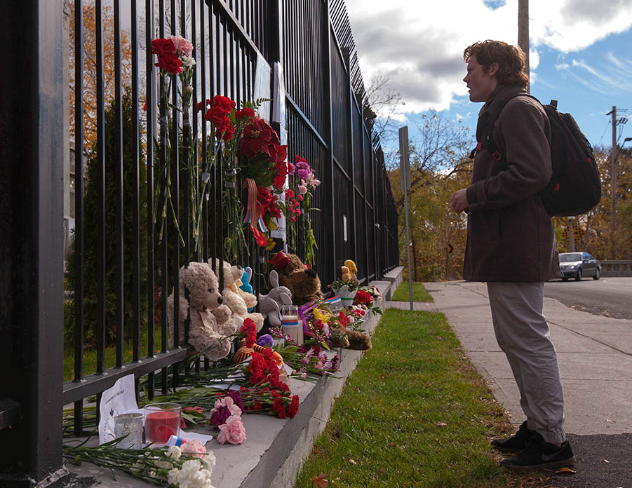 Man looks at memorial in front of Russian embassy - Ottawa - Nov. 2 2015